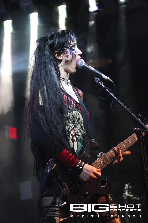 One-Eyed Doll guitar player