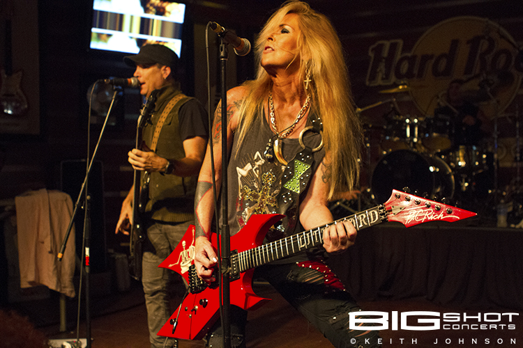 Lita Ford plays with her band