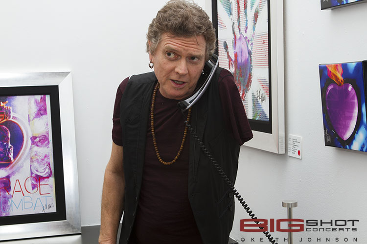 Rick Allen takes a break to answer the phone
