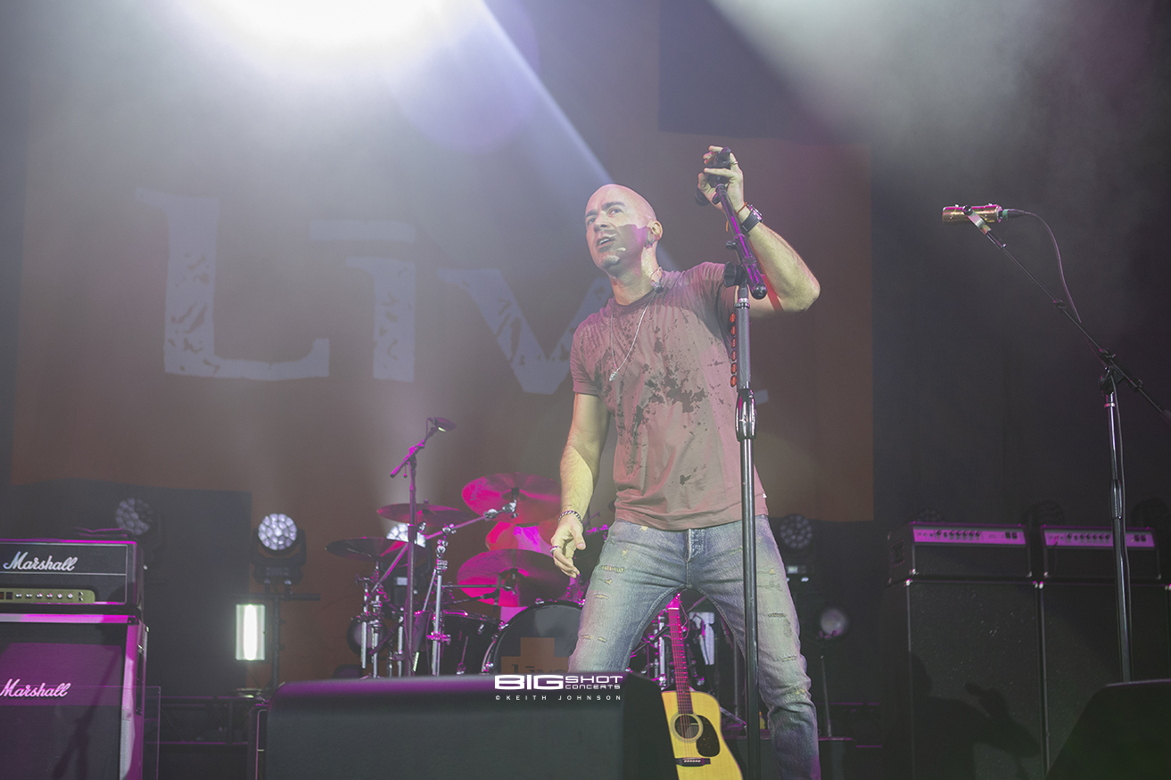 Concert photo of Ed Kowalczyk of LIVE under the stage lights