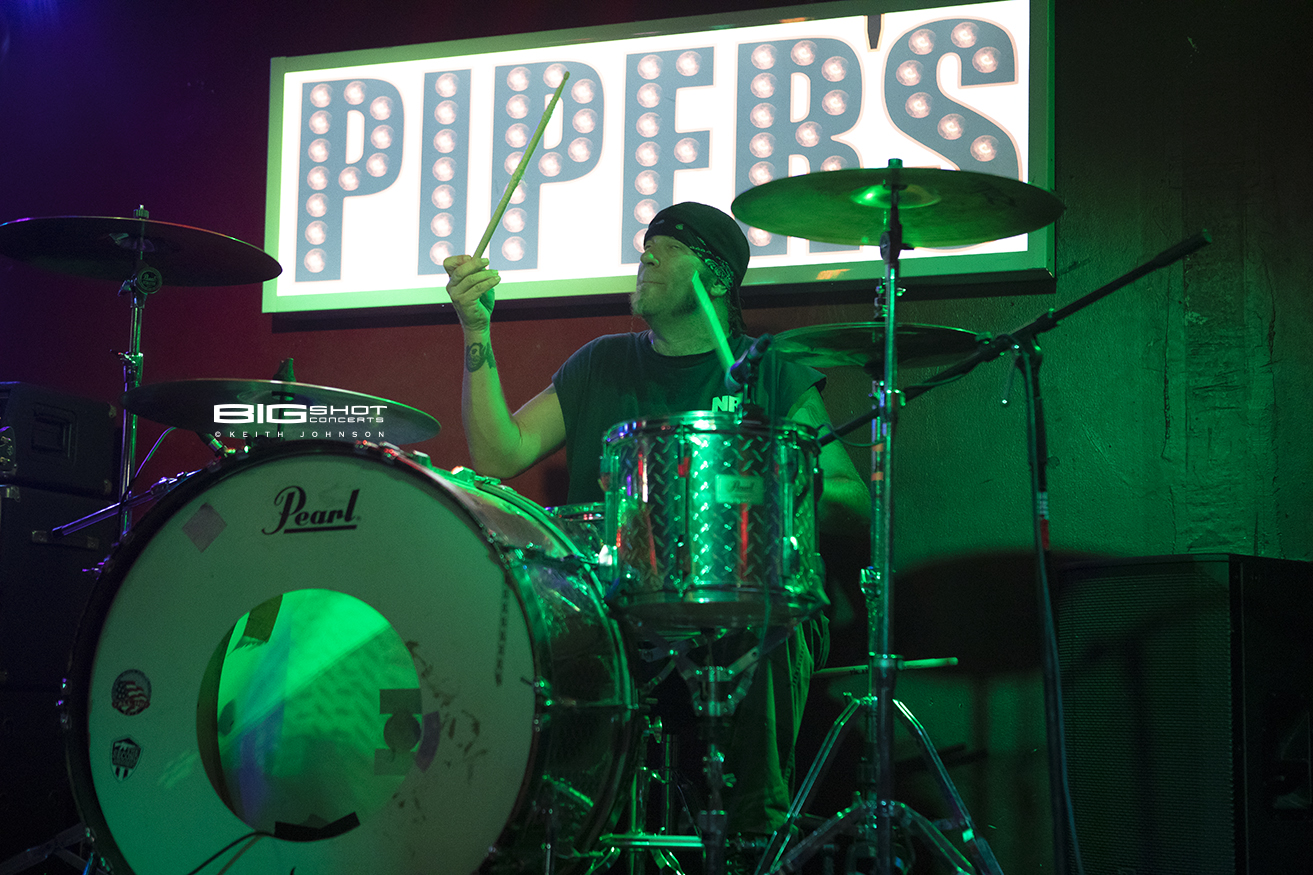 Drummer on stage at Piper's Sports Bar
